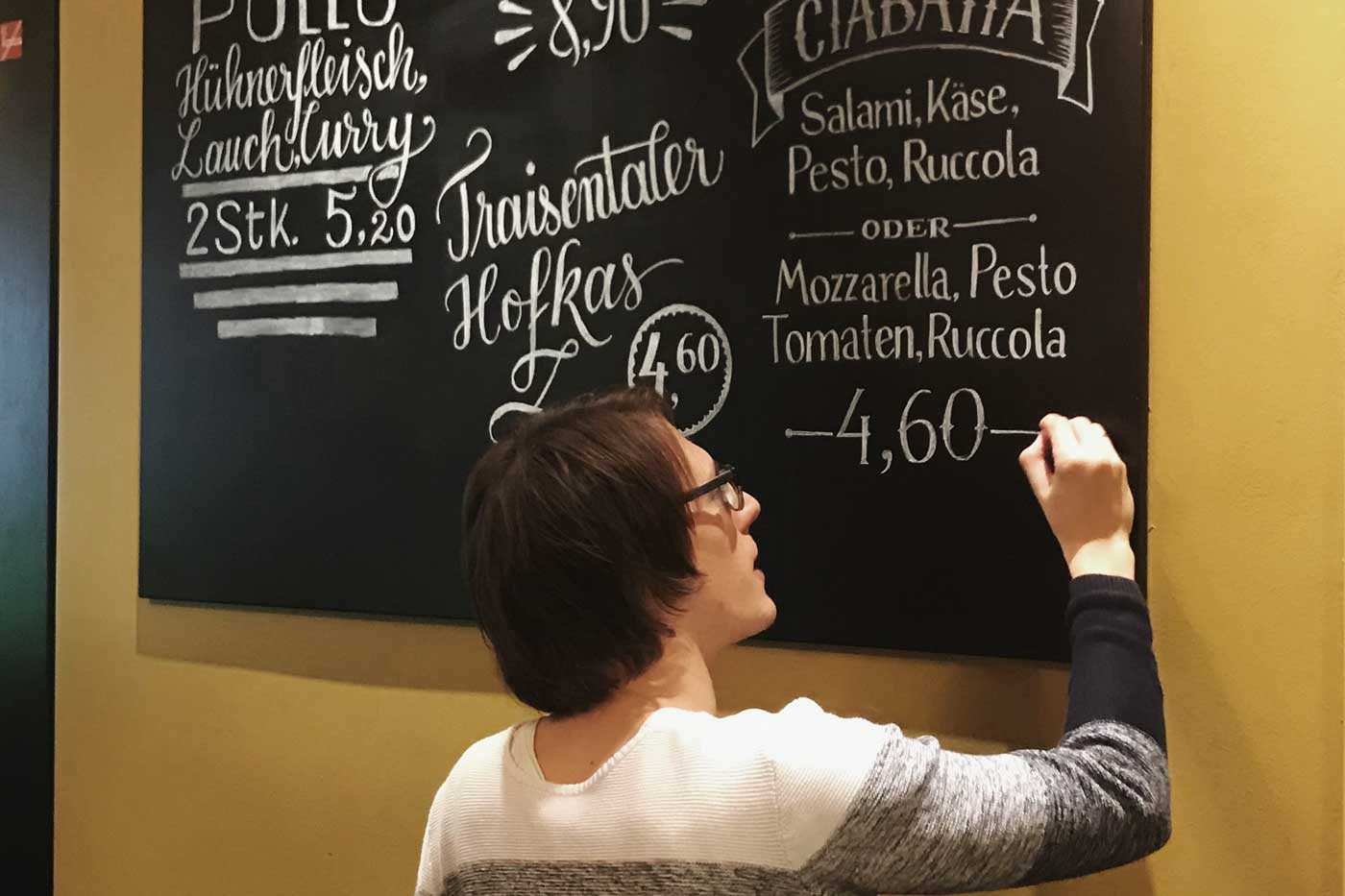 Adding the final touch to the chalkboard lettering